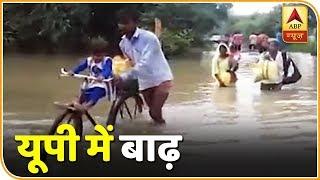 यूपी में बाढ़: वाराणसी में मणिकर्णिका घाट पर शवदाह में आ रही बाधा, बाराबंकी-जालौन में भी परेशानी