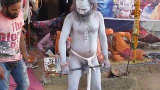 A Naga Sadhu displaying his yogic abilities