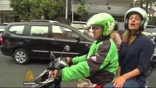 5989 economics Al Jazeera Motorbike app shakes up traditions in Indonesia