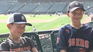 Boy who catches foul ball gives ball to another young kid