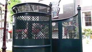 Pissoirs on the street in Amsterdam Public toilet for men to pee in Green  cages