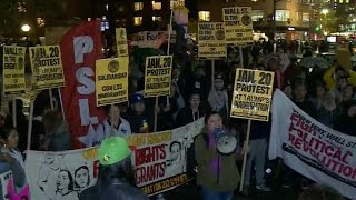 Protesters surround Trump Tower
