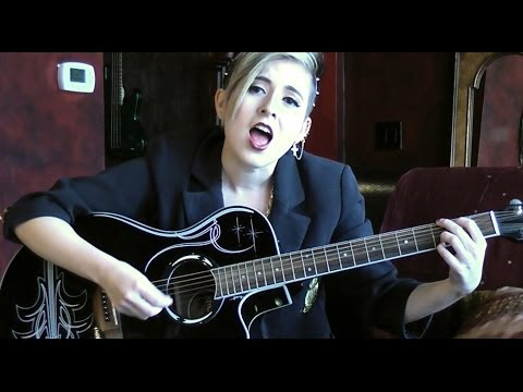 Female Guitar Player with Incredible Voice