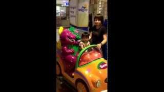Megan riding Barney's car
