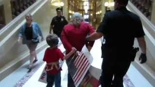 Arresting a Mom With Her Young Child at WI Capitol for Singing 7.26.2013