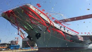 China's first domestically-built aircraft carrier Type 001A hits the water