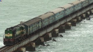 Train crossing Pamban bridge on a windy day.