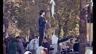 Iranian woman who waved her hijab in protest is 'missing'
