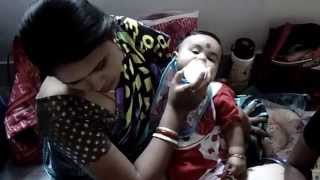 Cute Child Drink Milk In Her Mother lap