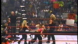 Trish Stratus puts Lita through a table (July 17, 2000)