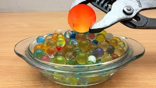 EXPERIMENT Glowing 1000 degree METAL BALL vs Orbeez Satisfying