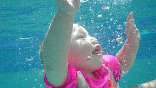 babies love swimming underwater