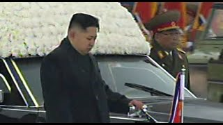 Scenes of mass grief as mourners line streets at funeral for Kim Jong Il