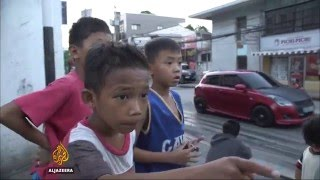 Children in Philippines forced to beg to survive