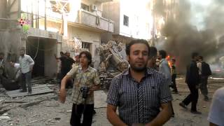 2015.8.24 : لحظة استهداف حي سكني في مدينة دوما بصاروخ موجه حرائق وأشلاء ورعب وصراخ