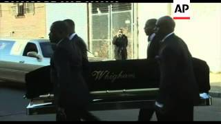 Whitney Houston's casket carried from hearse to church