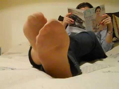 reading and relaxing nylon feet