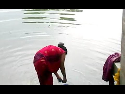 The Desi Girls Bathing videos in local Pond.