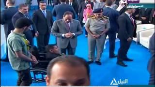 """مؤتمر الشباب الثالث - الرئيس السيسي  يبعد """"  الذباب  """" عن شاب من ذوي الإحتياجات الخاصة"""