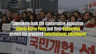 Opposition lawmakers protest the proposed constitutional amendment