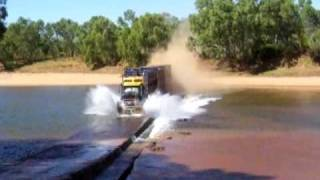 Road Train going flat-out over a river crossing - Western Australia