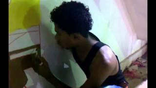 """رسم صورة حائطية """"سبونج بوب """" على سطح مكلا مول :)"""