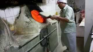 Baking Iranian style bread in a large clay oven. Kuwait City 2014.