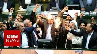 Iranian politicians set fire to US flag in parliament - BBC News