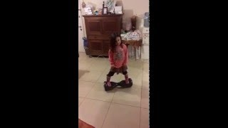5 years old girl mastering a hoverboard