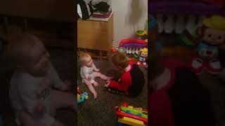 Leigh and Hunter playing with the toys