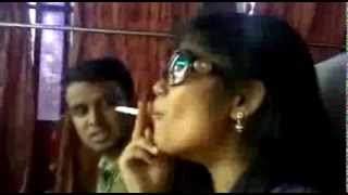 Bangladeshi lady is somking in open bus