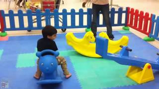 Children Playing In The Park with Trampoline Slide SeeSaw Basketball Theme Park