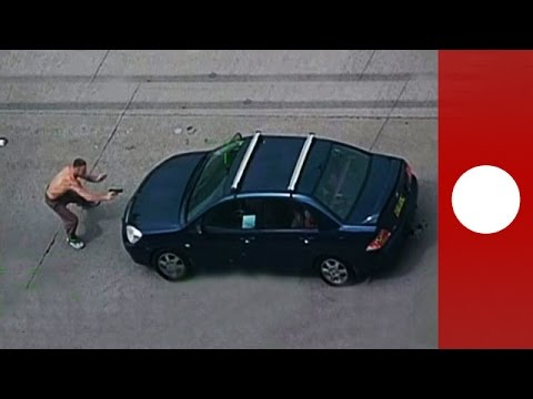 Carjacking fail Armed men run into oncoming traffic pursued by police