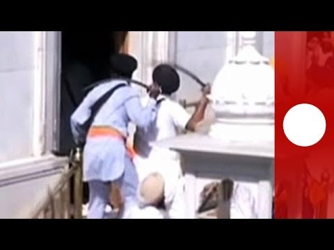 Xxx Mp4 Dramatic Sword Fight Breaks Out Between Sikhs At Golden Temple In India 3gp Sex