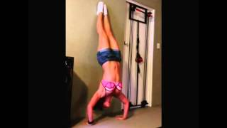girl does handstand push up