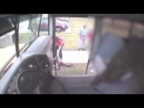 Raw: School Bus Driver Pushes Girl Out Door