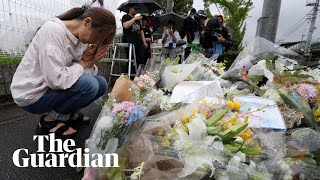 Mourners pay tribute to victims of the Kyoto Animation studio fire