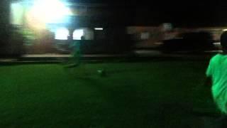 Boy runs in the goalpost