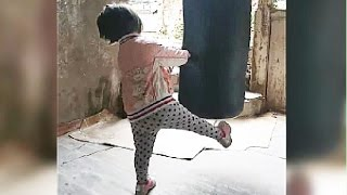 Cute and Funny Toddler Girl  Trying Boxing Bag For The First Time