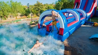 GIANT BACKYARD WATERSLIDE INTO 1,000 POUNDS OF DRY ICE!