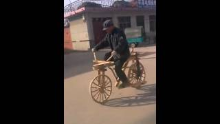 Chinese farmer made a wood bicycle for himself