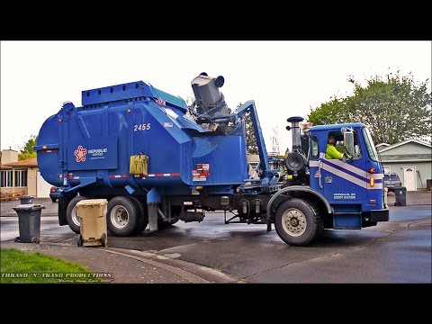 Garbage Trucks On Route In Action