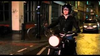 Woman rides and kickstarts Ural motorcycle