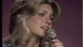 Olivia Newton-John sings