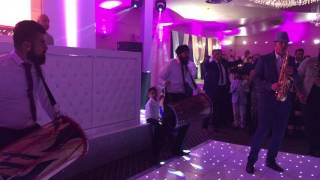 Sax & dhol drums playing Indian wedding entrance.