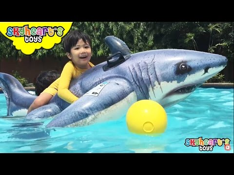 Skyheart rides the GIANT SHARK swimming toys for kids playtime with inflatables and surprise eggs