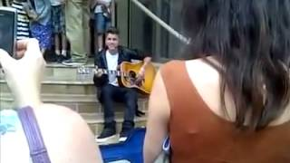 Justin Bieber singing on steps of the Avon Theatre in his hometown Stratford, Ontario