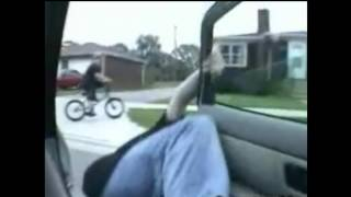Stupid guy gets hit by a car in the face