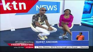 Controversial Rapper CMB Prezzo tries to hit on Friday Briefing anchor Betty Okari on air