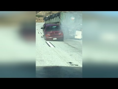 Truck Driver Doesn t Realize He s Dragging Car Along Highway for a Half Mile
